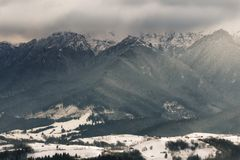 Bucegi Mountains. The peaks of Bucegi Mountains covered in heavy fog on a winter day Stock Images