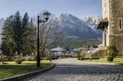 Bucegi Mountains, seen from Cantacuzino Palace yard. Bucegi Mountains, with the Caraiman Peak, seen from Cantacuzino Palace yard, Busteni, Romania Royalty Free Stock Image
