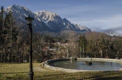 Bucegi Mountains, seen from Cantacuzino Palace yard. Bucegi Mountains, with the Caraiman Peak, seen from Cantacuzino Palace yard, Busteni, Romania Stock Images