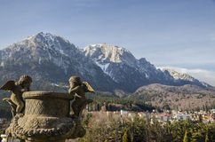 Bucegi Mountains, seen from Cantacuzino Palace yard Royalty Free Stock Photos