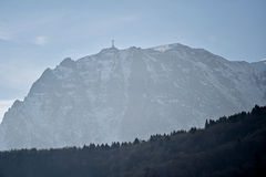 Bucegi mountains in winter with the Heroes Cross on Caraiman Pea Royalty Free Stock Photo