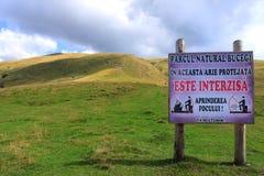 Bucegi natural park. Transbucegi,Romania.Protected area and sign that indicate forbidden firing Stock Photography