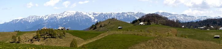 Bucegi panorama. View of Bucegi mountains from Pestera village, Romania royalty free stock photo