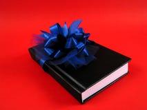 Buch als Geschenk Stockfotografie