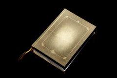 Buch auf einem schwarzen Hintergrund Stockbilder