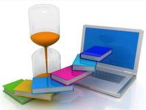Buch, ein Hourglass und ein Laptop Lizenzfreies Stockbild