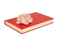 Buch mit Bogen lizenzfreies stockbild