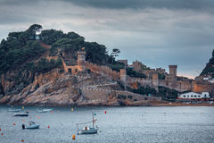 Buch sea with boats the famous Village of Tossa de Mar on the Costa Brava at Night,Catalonia,Spain royalty free stock photo