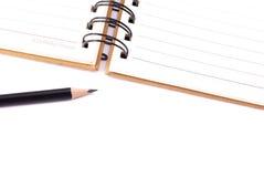 Buch und Bleistift Stockfoto