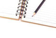 Buch und Bleistift Lizenzfreie Stockfotos