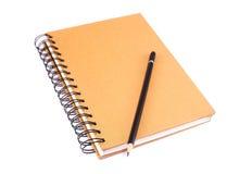 Buch und Bleistift Stockbild