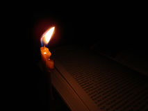 Buch und Kerze Lizenzfreie Stockfotografie