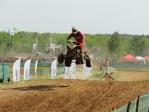 Quad bike riding motocross rally racing competition stock images