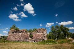 Summer view to castle ruins in Buchach with beautiful sky and clouds, Ternopil region, Ukraine. Buchach castle ruins, Ternopil region, Ukraine. Dating to 14th Royalty Free Stock Photo