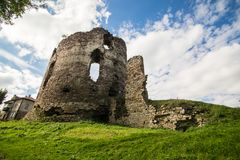 Summer view to castle ruins in Buchach with beautiful sky and clouds, Ternopil region, Ukraine. Buchach castle ruins, Ternopil region, Ukraine. Dating to 14th Royalty Free Stock Images
