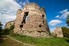 Summer view to castle ruins in Buchach with beautiful sky and clouds, Ternopil region, Ukraine. Buchach castle ruins, Ternopil region, Ukraine. Dating to 14th Royalty Free Stock Photos