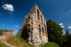Summer view to castle ruins in Buchach with beautiful sky and clouds, Ternopil region, Ukraine. Buchach castle ruins, Ternopil region, Ukraine. Dating to 14th Stock Photography