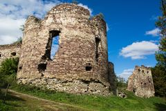 Summer view to castle ruins in Buchach with beautiful sky and clouds, Ternopil region, Ukraine. Buchach castle ruins, Ternopil region, Ukraine. Dating to 14th Stock Image