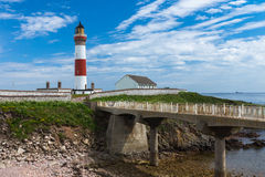 Buchan Ness Lighthouse. Photo of Buchan Ness lighthouse on the Scottish North East coast at Boddam Stock Images