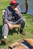 Male Confederate Reenactor Next to the Campfire stock images