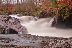 Buchanty Spout near Crieff in Scotland. Fierce waterfall at Buchanty Spout at which salmon are spotted leaping upstream in the aun stock images