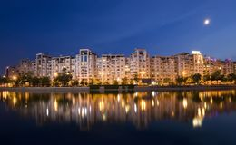 Bucharest. Dambovita river and buildings reflected in water, Bucharest  Romania. night scene Stock Image