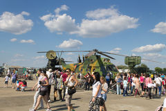 Bucharest Air Show: people at the helicopter. People inspecting a Romanian Air Forces medical transport helicopter and other combat equipment at the Bucharest stock images