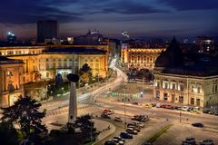 Bucharest central library  at blue hour in summer time. Cityscape, revolution square , Hilton and Royal Palace Royalty Free Stock Image