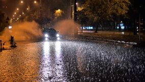 Bucharest city after heavy rain during the summer time. Car crossing the flood , bad whether royalty free stock photos