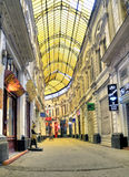 Bucharest - glass covered street. Macca-Vilacrosse passage is a fork-shaped, yellow glass covered street in central Bucharest, Romania. Built in 1891 it hosted Royalty Free Stock Photos