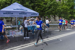 Marathon runners drink water Stock Image