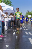 Runner take a water in a marathon race Royalty Free Stock Images