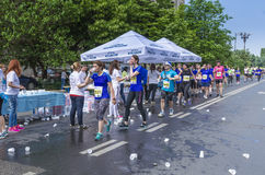 Runners take a water in a marathon race Royalty Free Stock Photo