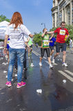 Runners take a water in a marathon race Stock Photos