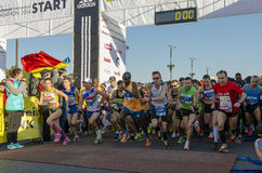Athletes start marathon race Stock Image