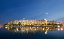 Bucharest at night. Bucharest night scene with Dambovita river and moon. Romania Stock Photography