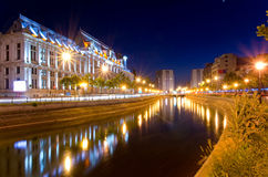 Bucharest by night - Palace of Justice. The Palace of Justice is located in downtown Bucharest, Romania, on the banks of the Dâmboviţa River . Built between Stock Photo
