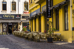 Bucharest old town. Restaurant with tables on cobblestone street in the old town Bucharest on April 14, 2014 in Bucharest, Romania Royalty Free Stock Photos