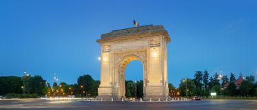 Bucharest, The Triumphal Arch at dusk. Bucharest, Panorramic view of the Triumphal Arch or Arcul de Triumf at dusk Royalty Free Stock Photography