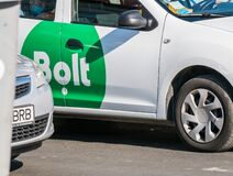 Free Bucharest/Romania 09.05.2020: Logo Of The Ride-hailing Estonian Transportation Platform Bolt Printed On A White Car. Bolt Driver Stock Photography - 197285242