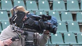 BUCHAREST,ROMANIA-APRIL 2015.BRD Nastase Tiriac Trophy 2015 professional tennis tournament.Cameraman recording a live match 4K stock video footage