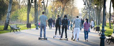 BUCHAREST, ROMANIA, - April 2, 2016: People using hoverboard, a self-balancing two-wheeled board, in the park.  Editorial content Royalty Free Stock Images