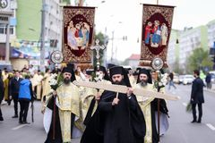 Romanian Orthodox priests during a Palm Sunday pilgrimage procession in Bucharest. Bucharest, Romania - April 20, 2019: Romanian Orthodox priests during a Palm royalty free stock images