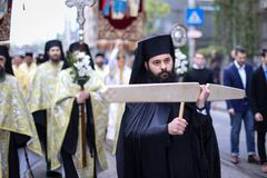 Romanian Orthodox priests during a Palm Sunday pilgrimage procession in Bucharest. Bucharest, Romania - April 20, 2019: Romanian Orthodox priests during a Palm royalty free stock photography
