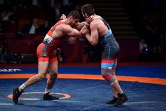 Taha Akgul from Turkey, competes against Geno Petriashvili, from Georgia, during the European Wrestling Championship in Bucharest stock photos