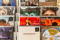 Vinyl Record Cases Of Famous Music Bands For Sale In Music Store Stock Image