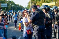 A woman speaking with riot police during the protest of Diaspora Royalty Free Stock Photo
