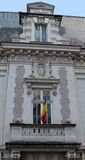 Bucharest, Romania: balcony with Romanian flag. Bucharest, Romania: building in French beaux arts style and balcony with Romanian flag near Piata Romana stock photography