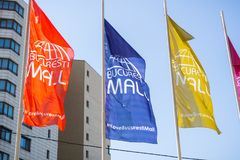 Bucharest Mall Colorful flags. Bucharest / Romania - Colorful flags waving in the wind on a blue sky background at the entrance to Bucharest Mall Royalty Free Stock Photography