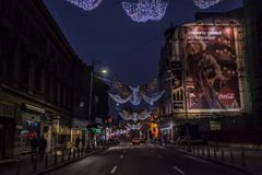 Bucharest nightlife in December with Christmas decorations on Calea Victoriei Boulevard royalty free stock images